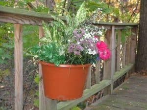 A unique hanging basket designed to fit on the posts of your wooden deck.
