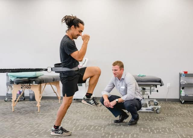 Physical Therapy Often Involves Exercises Like This Person Working With a Resistance Band.
